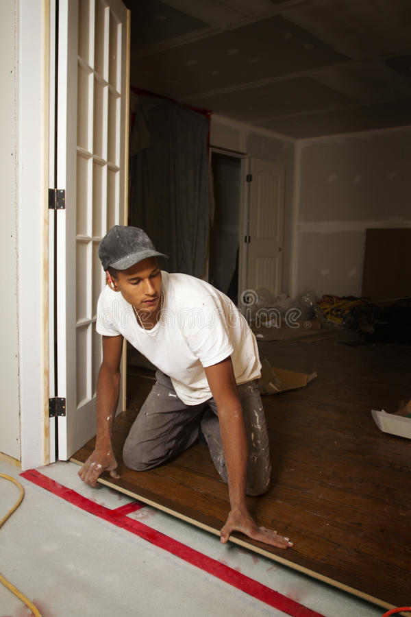 Download Portrait Of A Man Doing Flooring Stock Photo - Image of repairman, roof: 21906934