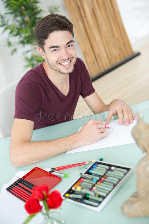 Portrait man drawing at home royalty free stock photo