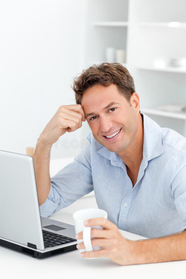 Portrait of man drinking coffee while working royalty free stock image