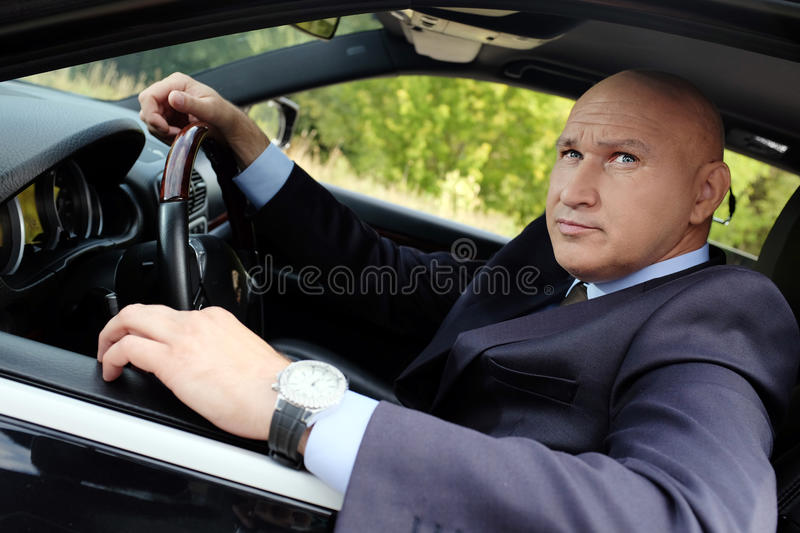 Portrait of a man driving a car royalty free stock images
