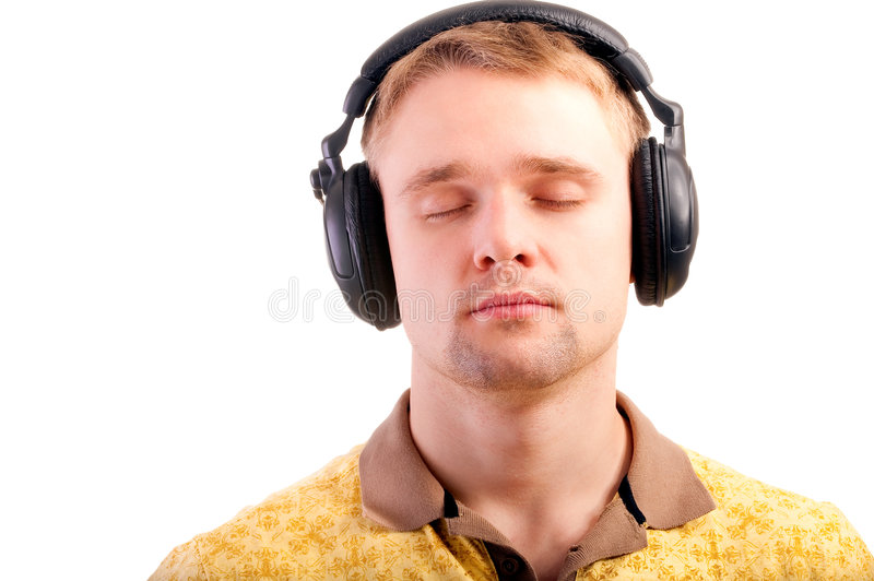 Portrait of man with ear-phones. Young man listens to beautiful music blindly stock photography