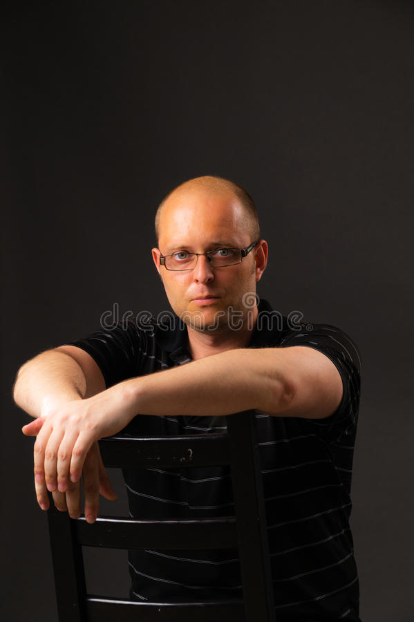 Portrait of the man in glasses stock image