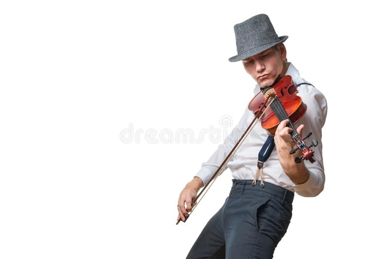 Man with hat plays the violin stock image