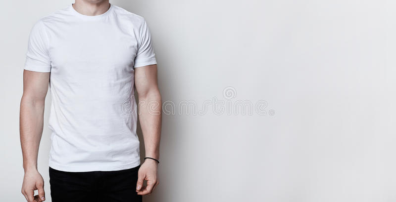 A portrait of a man having athletic body wearing blank white t-shirt standing on white background with copy space for your adverti. Sment. Clothes advertising.T stock images