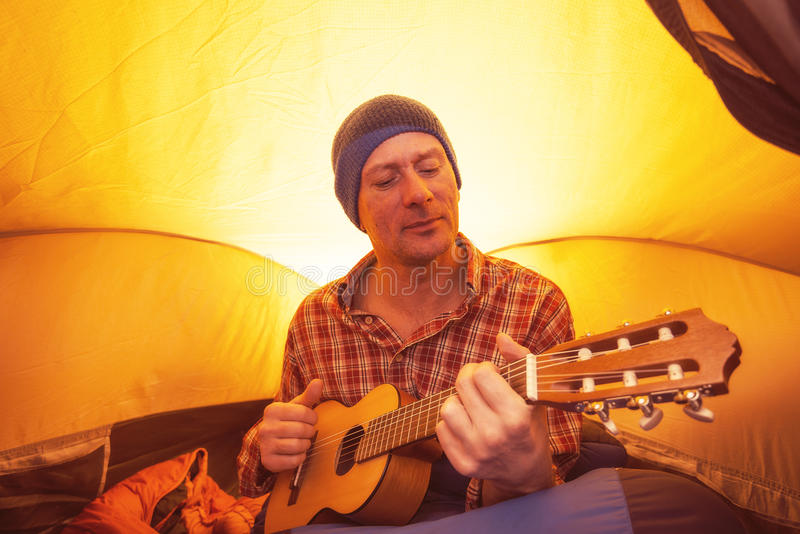 Download Portrait Of Man, Hiker Resting In A Tent With Ukulele Stock Photo - Image: 83704493