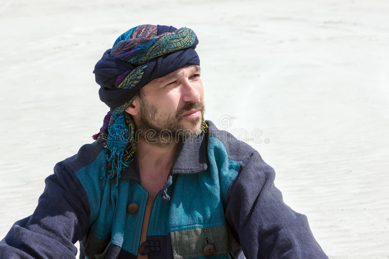 Portrait of a man in his turban against the backdrop of the dese stock photo