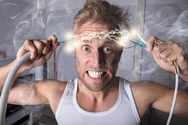 Man Holding Bared Wires royalty free stock photo