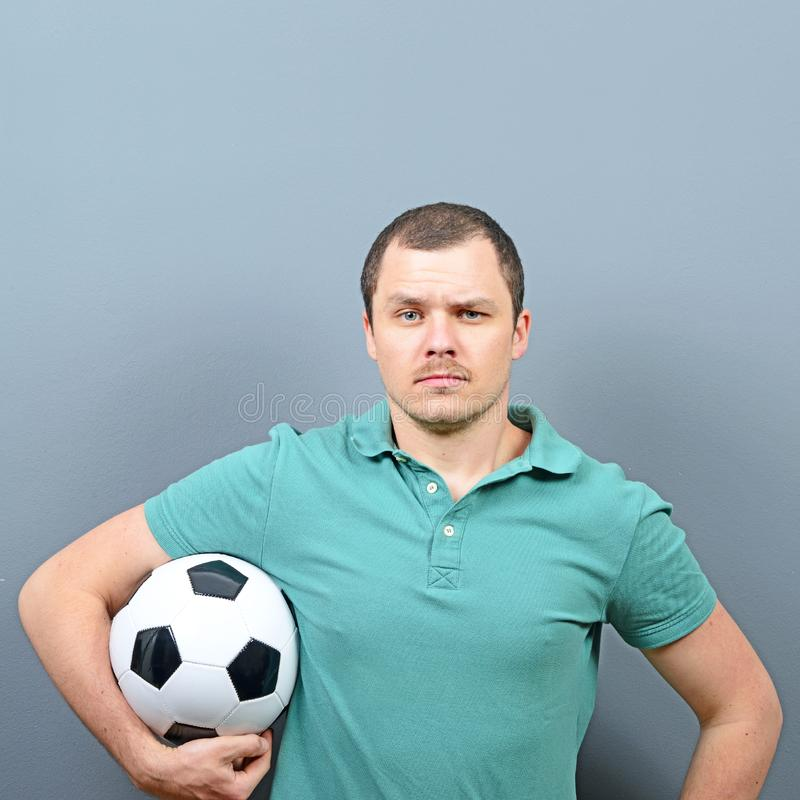Portrait of man holding football - Football fan supporter or player concept royalty free stock photos
