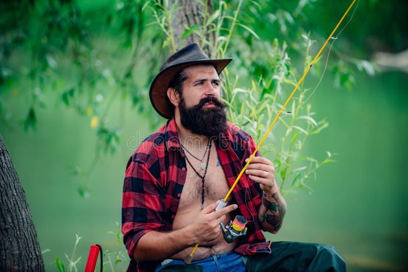 Portrait man on holiday. Fisherman fishing equipment. Set up rod with hook line sinker. Bearded elegant man. Mature man royalty free stock photo