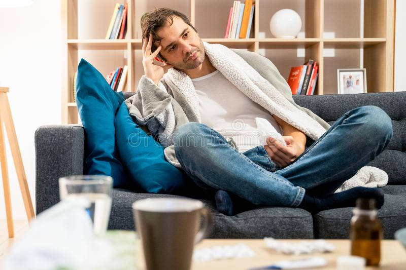 Portrait of man at home because of sick days royalty free stock photography