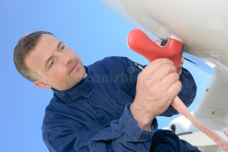 Portrait man inspecting aircraft royalty free stock photos