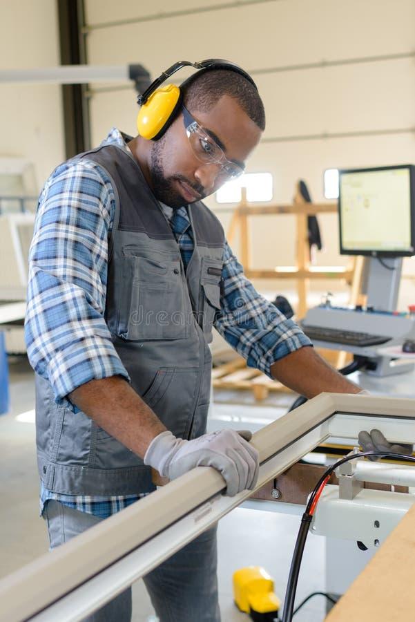Portrait man inspecting framework stock image