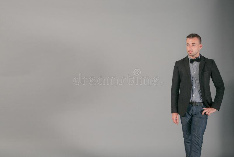 Portrait of man in jacket and bow tie royalty free stock images