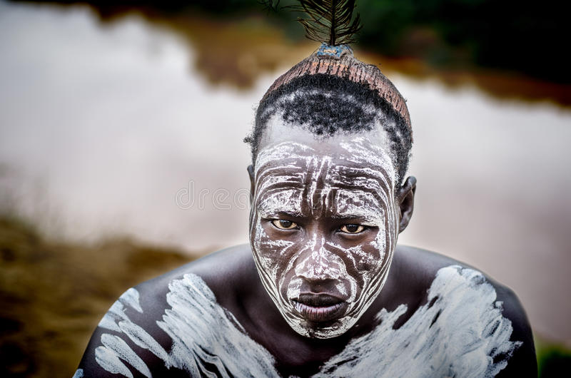 Portrait of a man from Karo tribe, Ethiopia. TURMI, ETHIOPIA - 12 AUGUST 2014: unidentified man from Karo tribe in his village near Omo River. Karo tribes are royalty free stock image