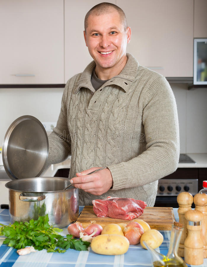 Portrait of man at kitchen royalty free stock image