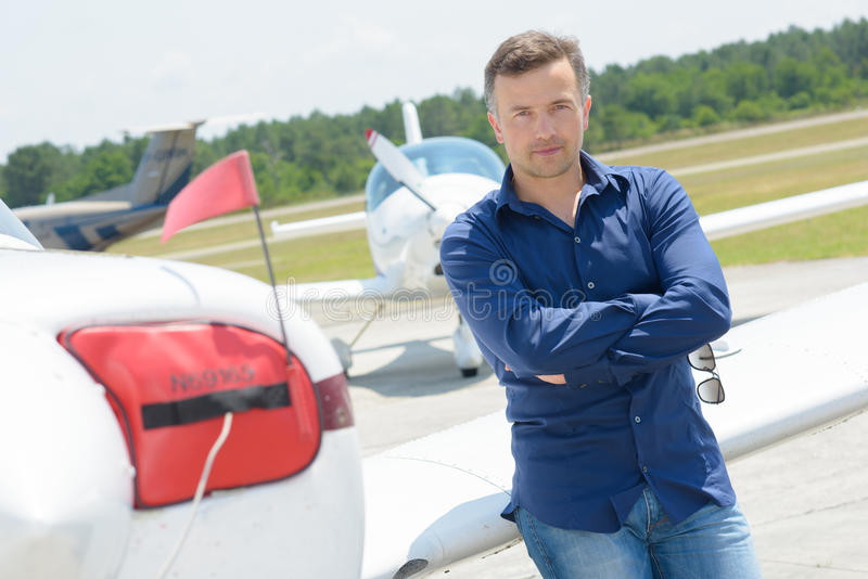 Portrait man leaning on aircraft. Portrait of man leaning on aircraft royalty free stock images