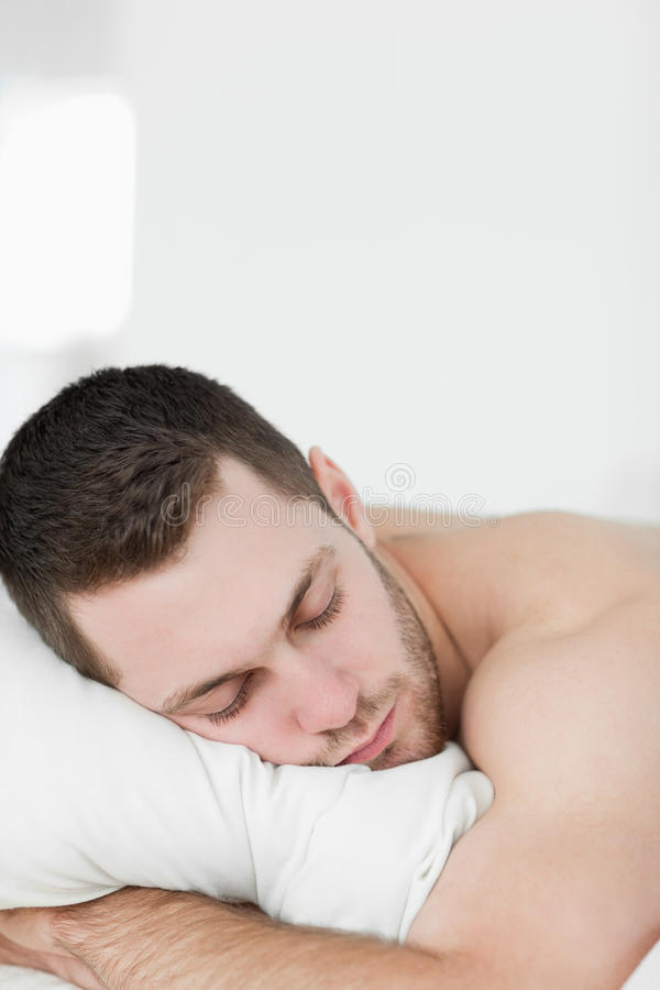 Portrait Of A Man Lying On His Belly While Sleeping Royalty Free Stock Images