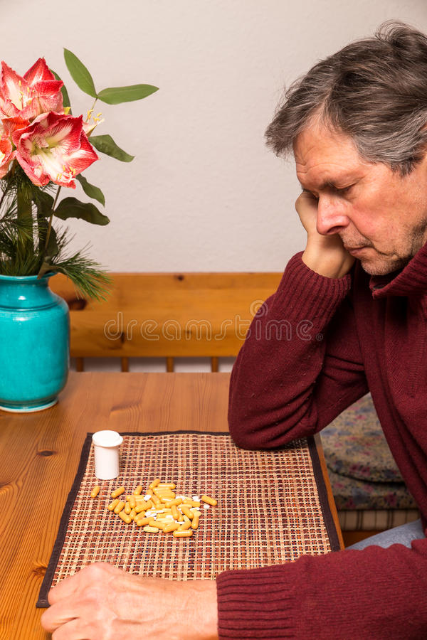 Portrait of a man with medications. Portrait of a elderly man with medications royalty free stock photography