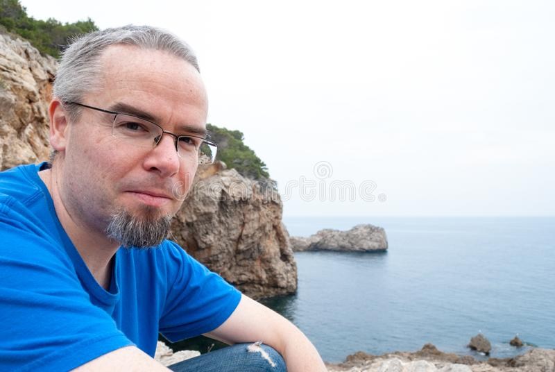 Portrait of a man with a natural paradise background royalty free stock image