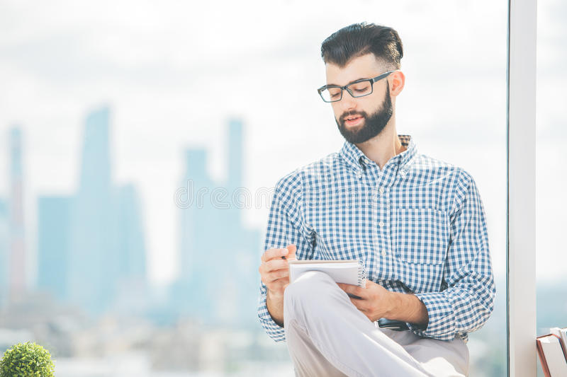 Portrait of man with notepad stock photo