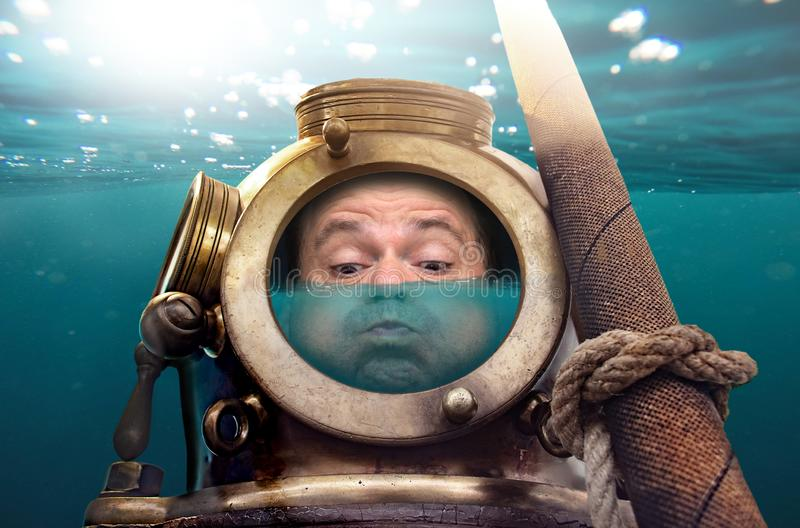 Portrait of man in old diving suit and helmet royalty free stock images