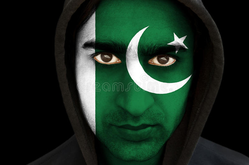 Portrait of a man with Pakistani flag face paint royalty free stock image