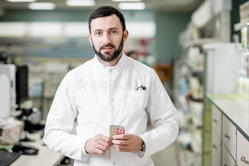 Pharmacist in the pharmacy store stock photography