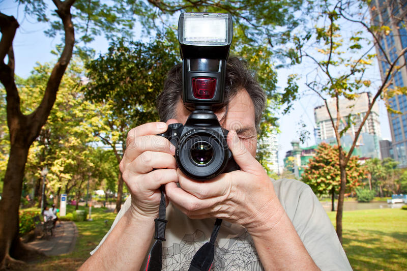 Portrait of the man-photographer at the park royalty free stock photos
