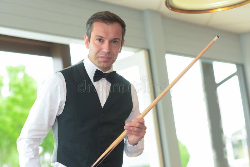 Portrait man playing billiards royalty free stock image