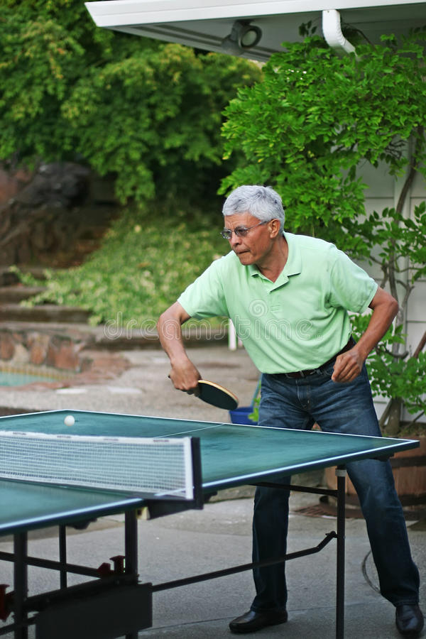 Portrait of a man playing table tennis royalty free stock photo