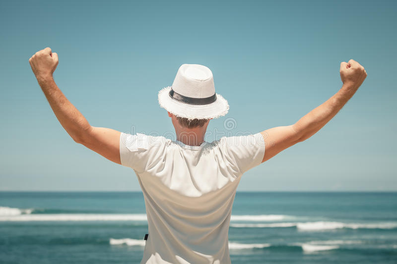 Portrait of man posing outdoor in summer sun light wearing hat.  stock photo