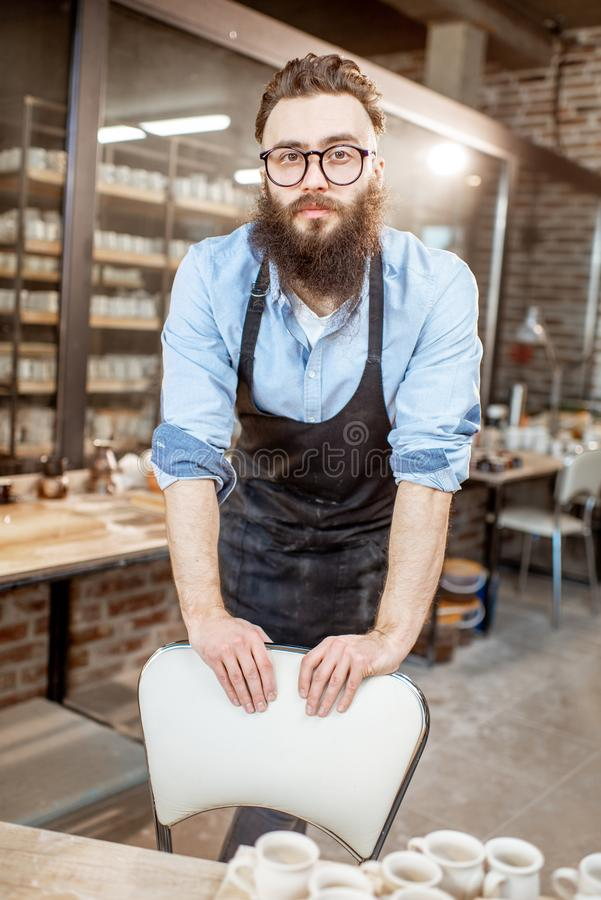 Portrait of a man in the pottery shop. Portrait of a creative man as a worker or business owner at the pottery shop stock photography
