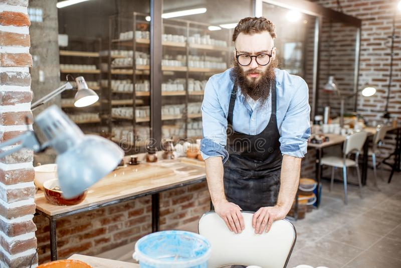 Portrait of a man in the pottery shop. Portrait of a creative man as a worker or business owner at the pottery shop royalty free stock images