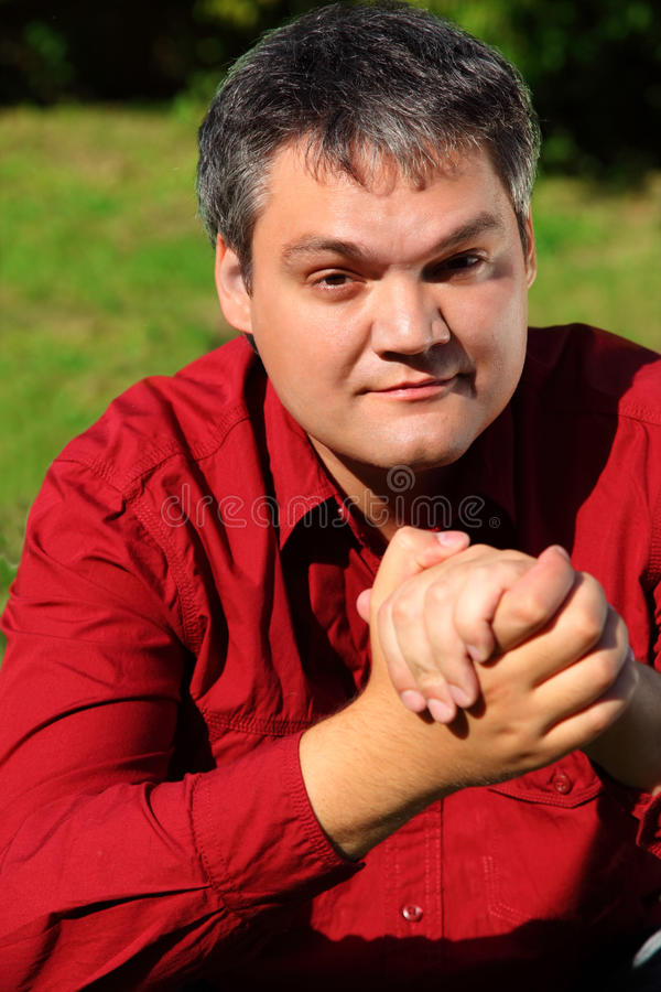 Portrait of man in red shirt outdoor royalty free stock image