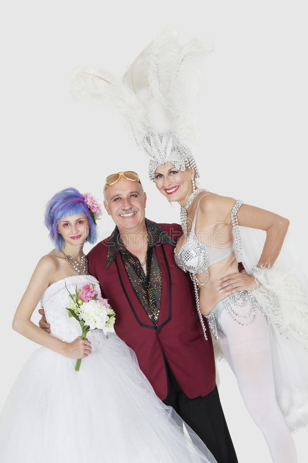 Download Portrait Of Man With Senior Showgirl And Daughter In Wedding Dress Over Gray Background Stock Photo - Image: 30851864