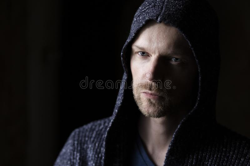 Portrait of man with serious expression on his face. stock photos