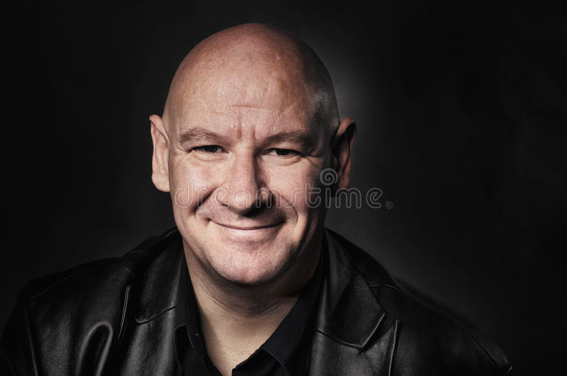 Portrait of man with shaved head stock photography
