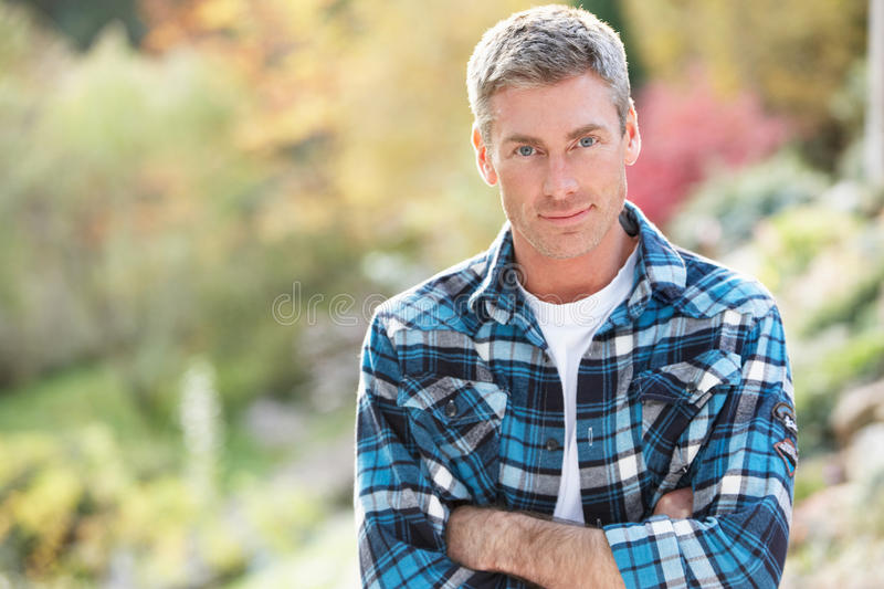 Portrait Of Man Standing Outside In Autumn royalty free stock images