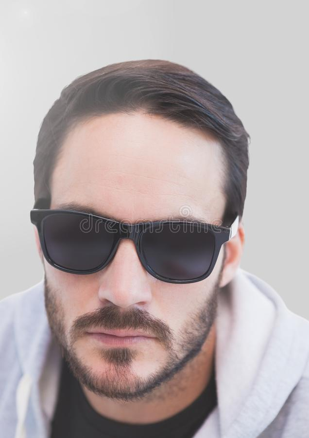 Portrait of Man in sunglasses with grey background_Man_0083 royalty free stock image