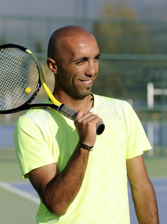 Portrait of a man with tennis racket stock image