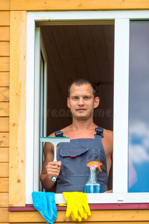 Portrait of a man with tools for washing windows royalty free stock photography