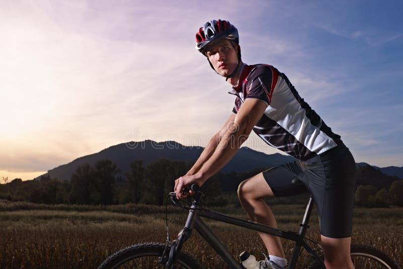 Portrait of man training on mountain bike stock photography