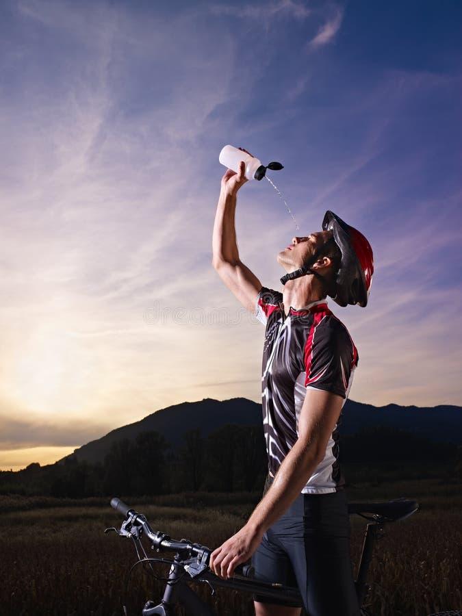 Portrait of man training on mountain bike royalty free stock photo
