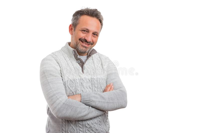 Portrait of man wearing knitted jumper. Portrait of man smiling with crossed arms wearing grey knitted jumper isolated on white studio background stock photos