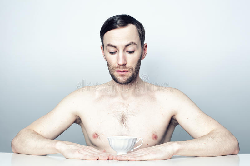 Portrait of a man with a white tea cup. royalty free stock image