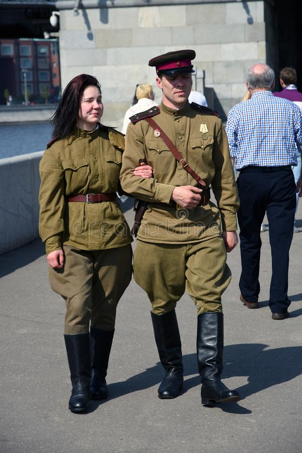 Portrait of a man and woman in military uniform. They are reenactors who pose for pictures at Victory day celebrations in Moscow, May 09, 2019, Gorky park. It royalty free stock photos