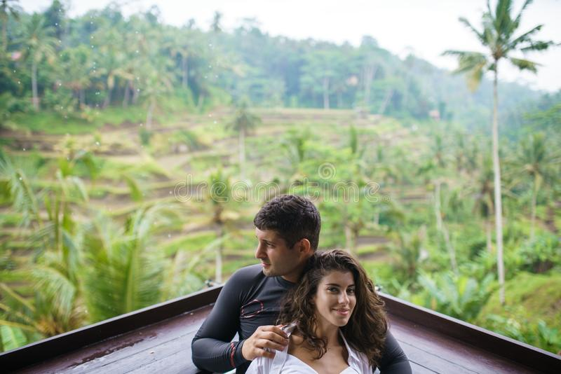 Portrait of a man and woman near the rice terraces in Bali royalty free stock photography