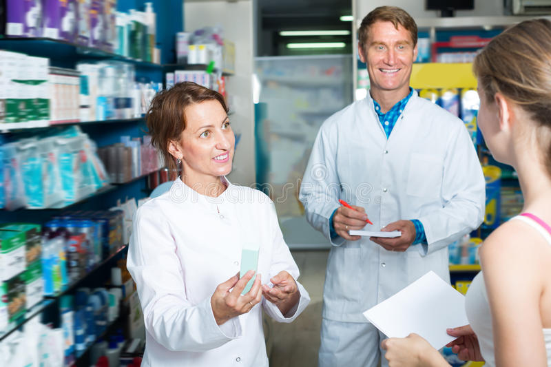 Portrait of man and woman pharmacists stock photos