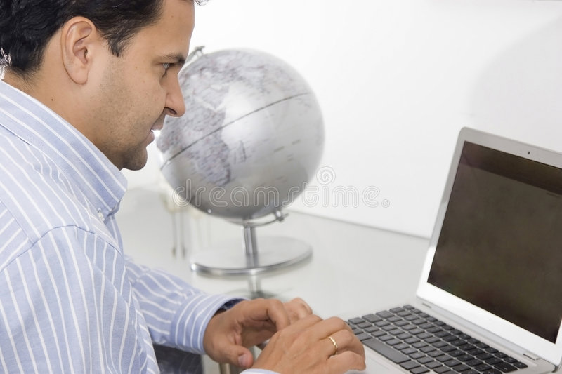 Portrait of a man working. At the office stock photo