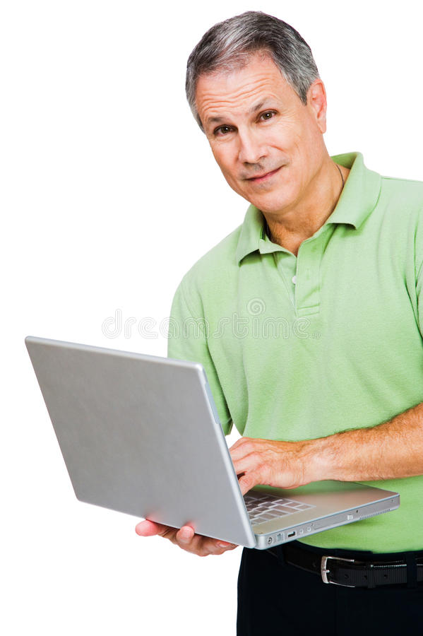 Portrait of a man working on laptop. Portrait of a man working on a laptop isolated over white royalty free stock image